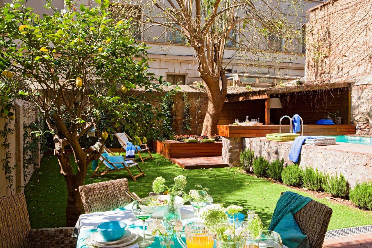 Una casa con jard n en medio de la ciudad for Casas pequenas con piscina y jardin