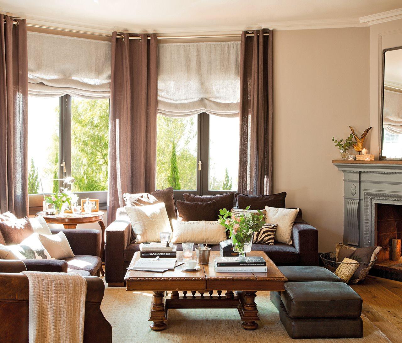 saln con doble ventanal sofs grises y chimenea qu cortinas pongo