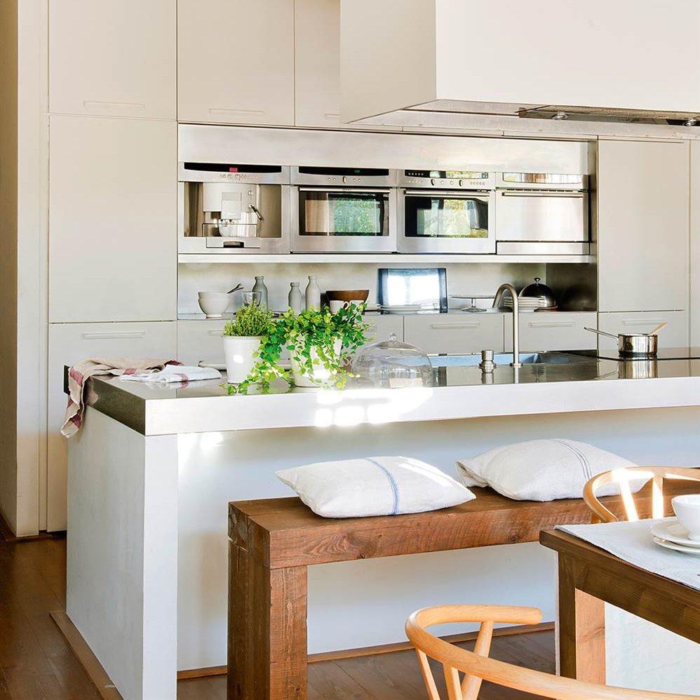 Claves para abrir la cocina al comedor o el sal n y ganar for Muebles modernos para cocina comedor
