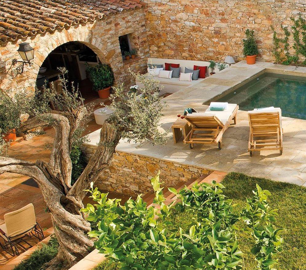 Una casa alrededor del porche - Casas y jardines ...