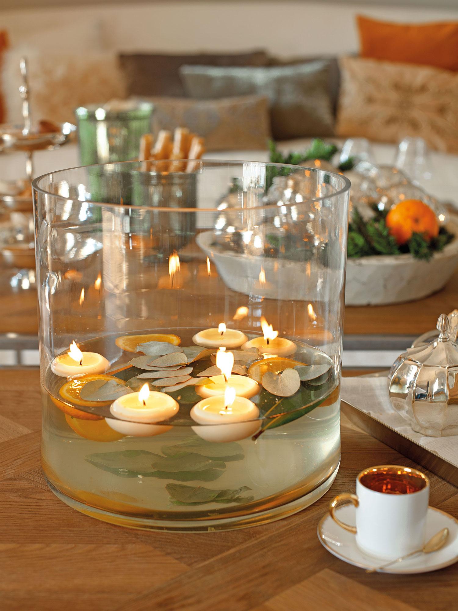 detalle de jarrn ancho con agua y velas