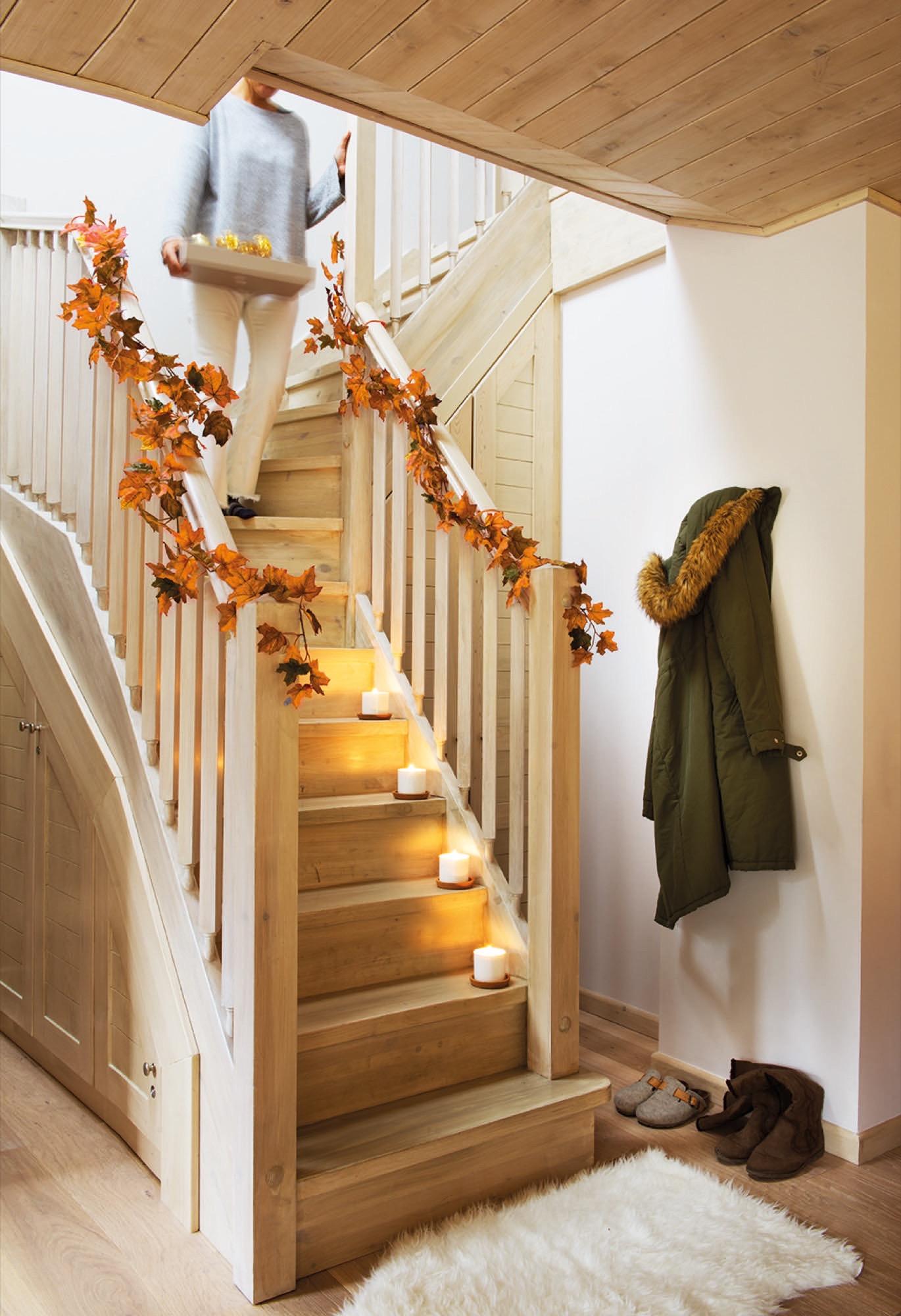 Una casa en baqueira de estilo n rdico en madera y blanco for Escalera madera adorno