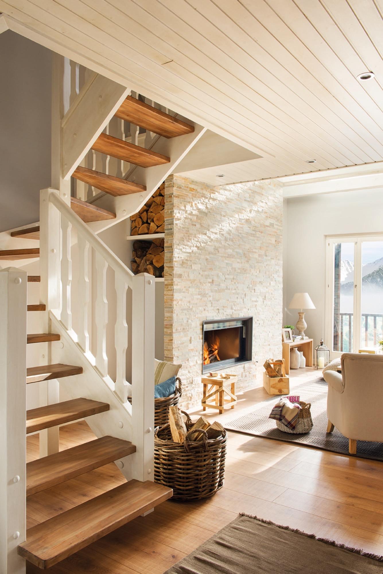 Una caba ita blanquita y muy n rdica for Huecos de escaleras modernos