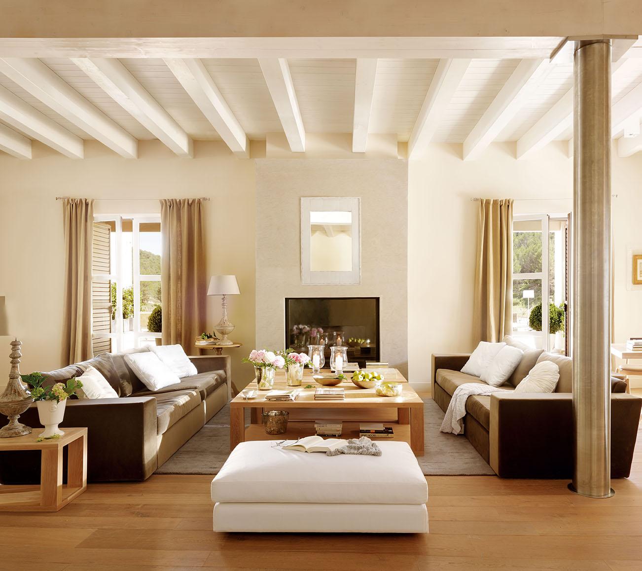 Salón Con Chimeneas Y Grandes Sofás Negros Con Cojines Blancos_00322399 12