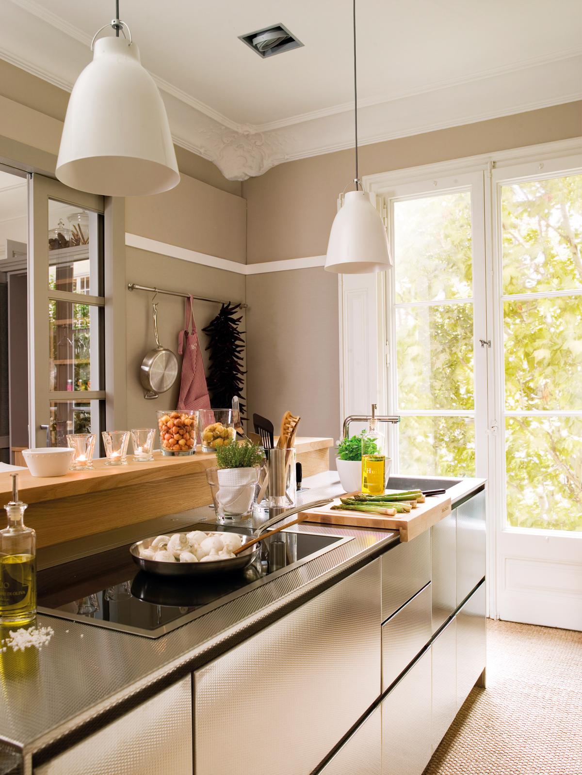 Tipos de encimera que le dar n un aire nuevo a tu cocina for Cocinas con islas en el medio
