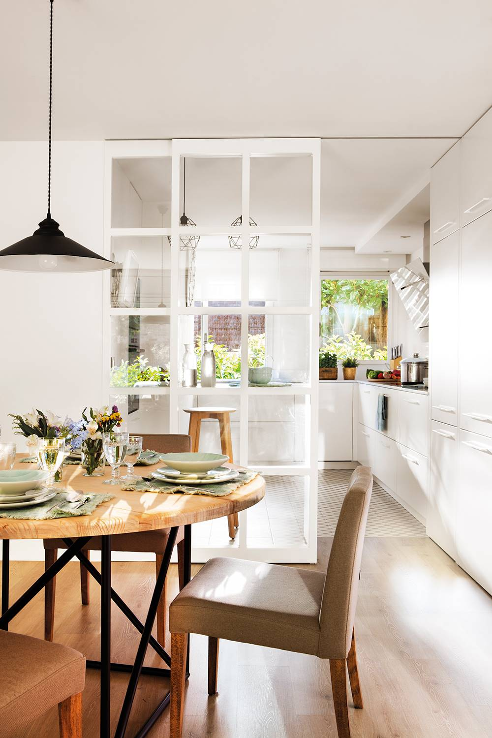 Kitchen-thousand-cabinets-00497485.  A semi-open kitchen with a glass panel