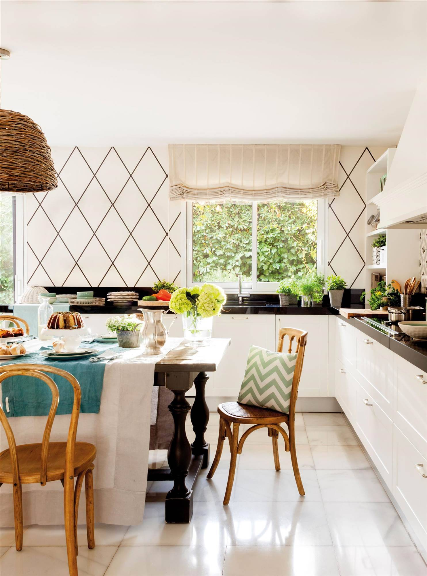 kitchen-with-office-in-white-and-black-with-wallpaper-and-table-and-wooden-chairs-00455058 d08c9c71 1484x2000.  34. Instead of tiles, do you have wallpaper?