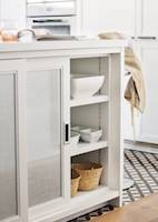 white kitchen detail sliding door with linen fabric 00503648. The cabinets look lighter