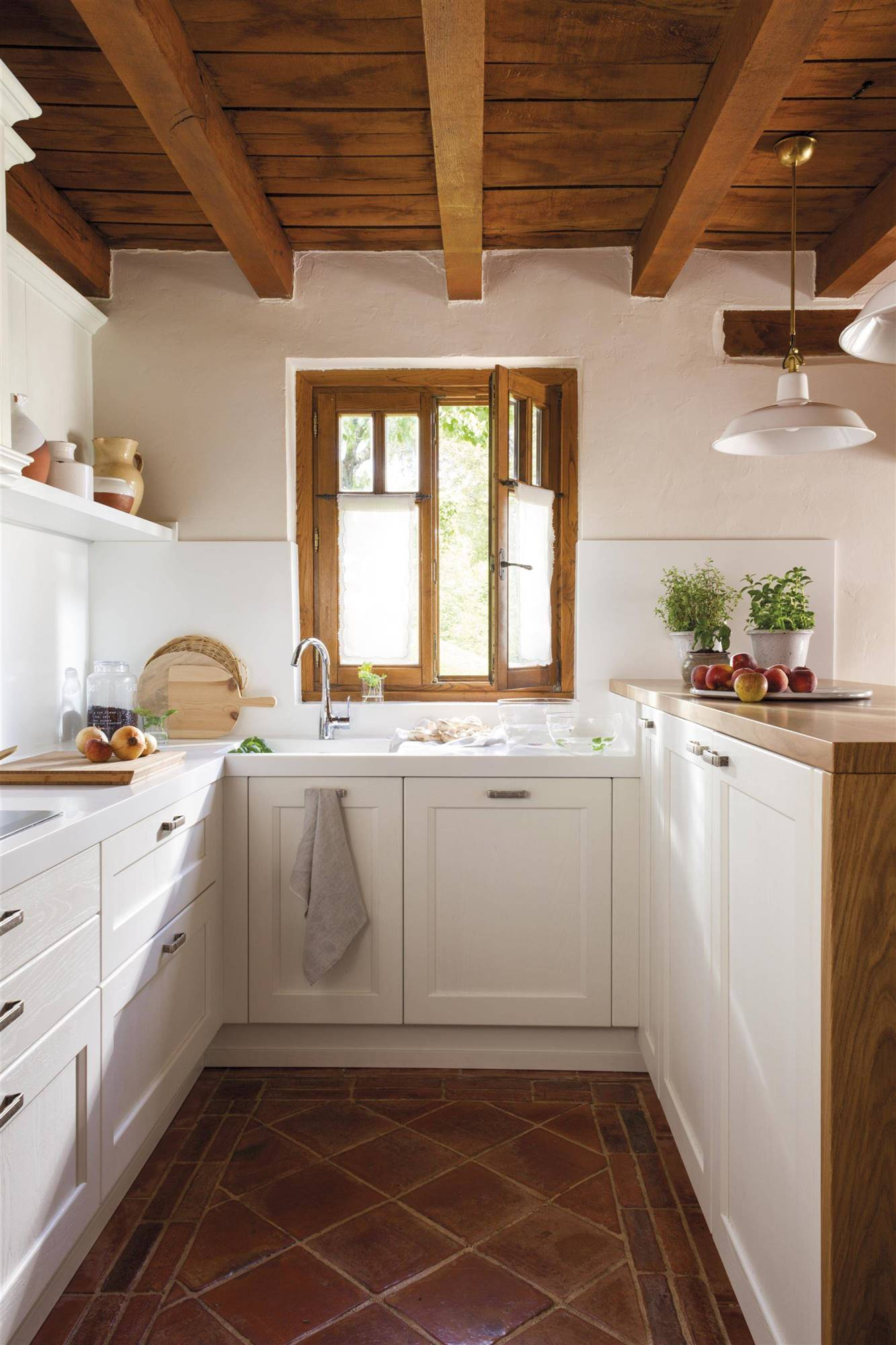 Small kitchen with wooden ceilings and windows, paved floors and white kitchen cabinets- 461030. 9. Wooden beams