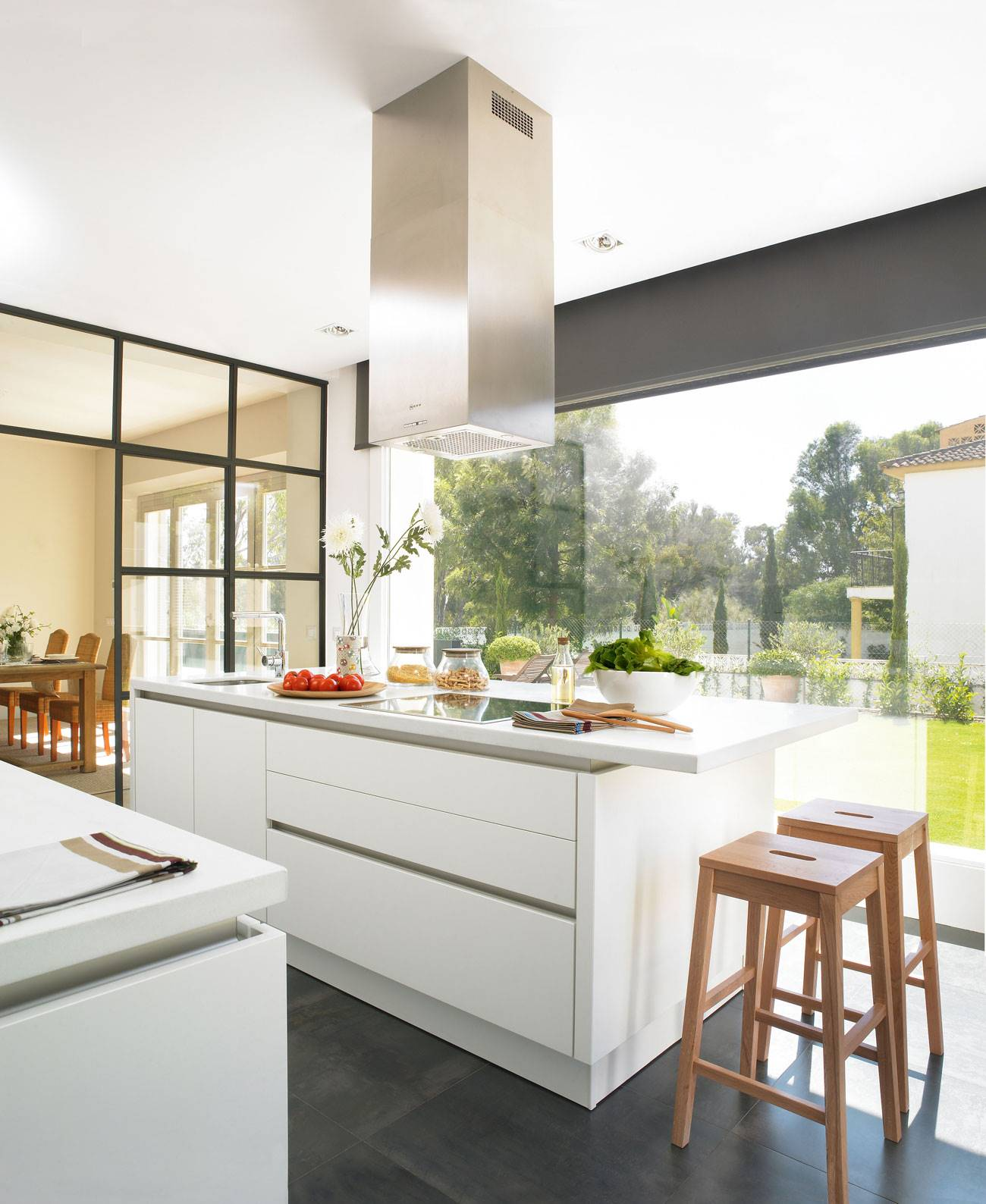 kitchen-with-island-front-large-window-with-garden-views 316220. Towards the garden