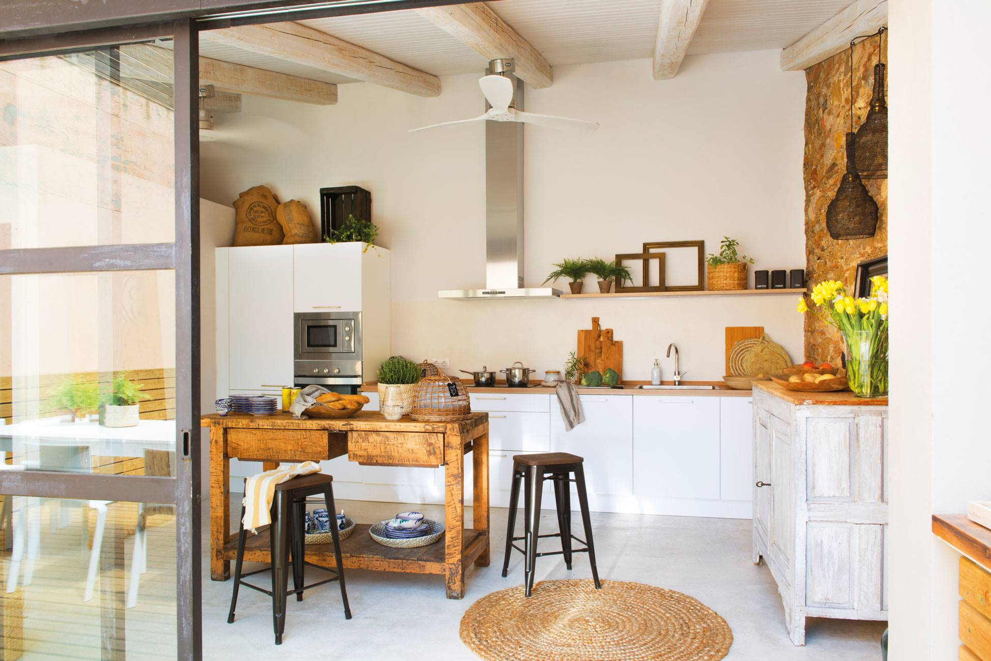 modern-rustic-kitchen-with-fan-and-old-table-as-island 438519. Very rustic