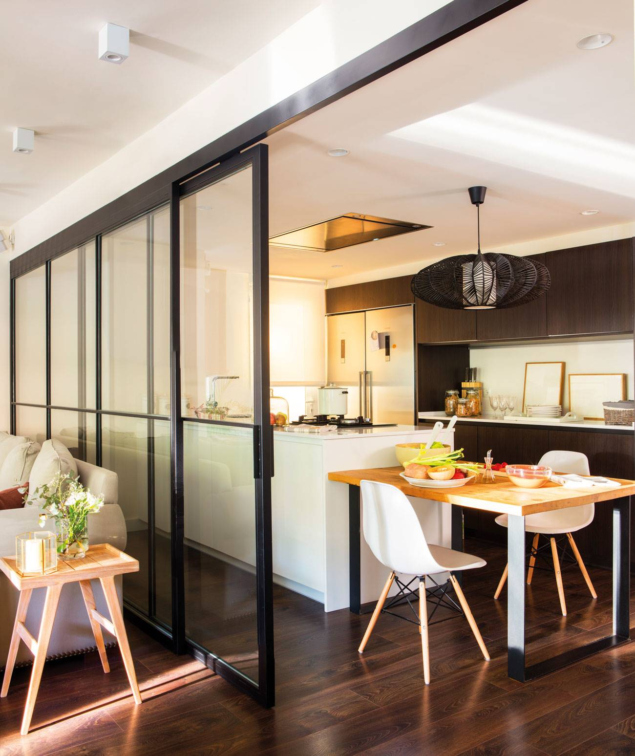 kitchen-separated-from-living-room-with-sliding-door-black-frames-to-match-with-kitchen-furniture-and-parquet 00444959. Dark and sophisticated
