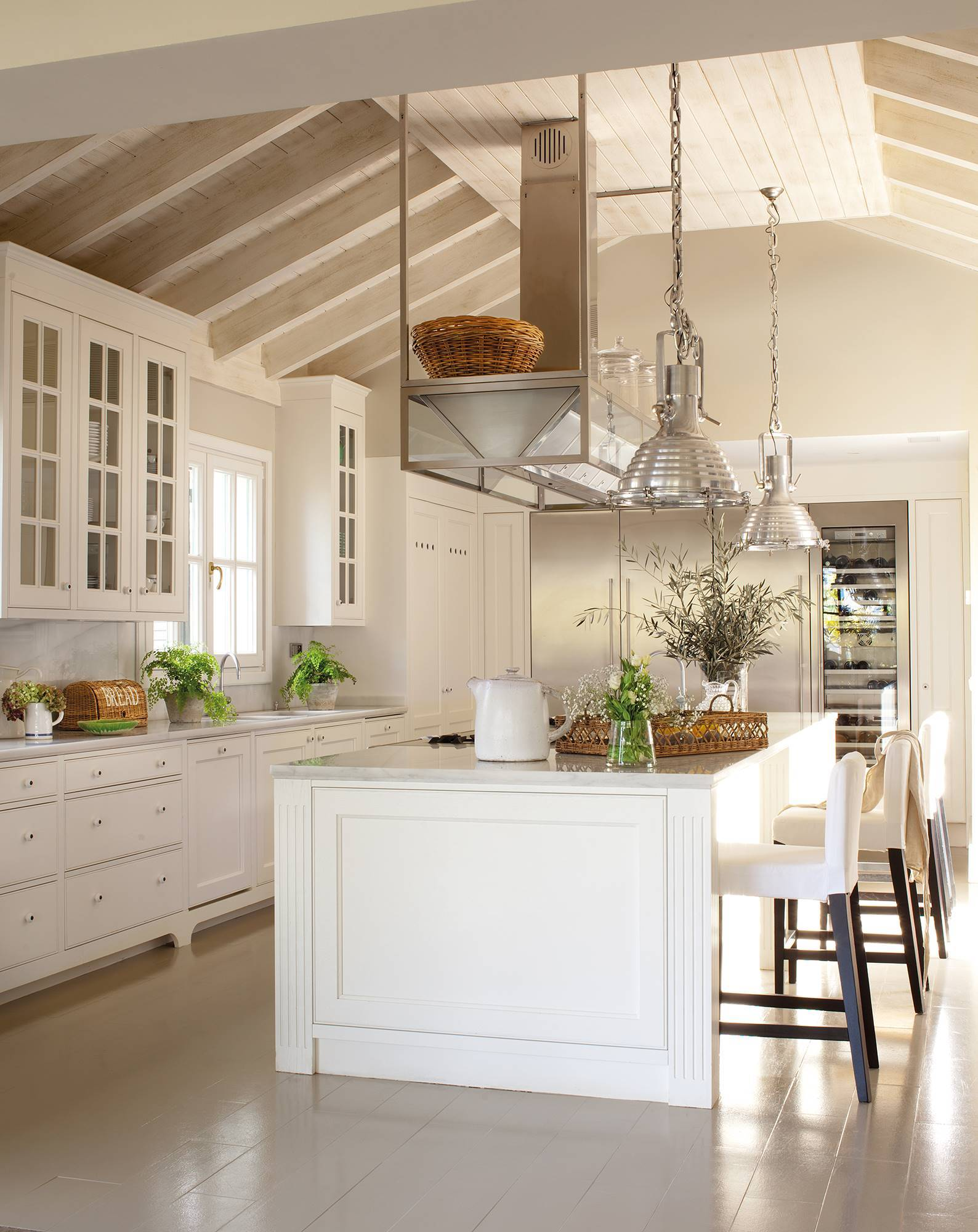 white-kitchen-with-gable-roof-and-large-central-island-with-stool-area -00376839 e55fc06b 1588x2000.  With touches of metal